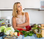 Tired woman leaning her elbows at the kitchen Royalty Free Stock Photo