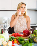 Tired woman leaning her elbows at the kitchen Royalty Free Stock Image