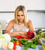 Tired woman leaning her elbows at the kitchen Royalty Free Stock Images