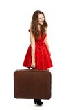 Tired woman with luggage Royalty Free Stock Images
