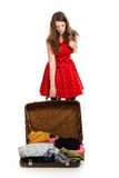 Tired woman with luggage Stock Images