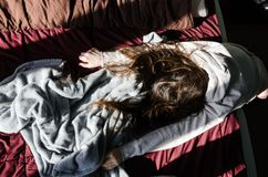 Tired woman lying in the bed stock photos