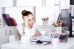 Tired woman manager in the office. After a hard day`s work Stock Photography