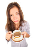 Tired woman in the morning. Tired woman with empty and bored eyes looking at the camera having spilled a little coffee. Beautiful mixed race asian / caucasian Stock Photo