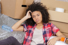 Tired woman during move. A tired woman during move Stock Photo