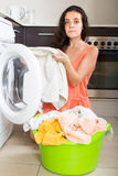 Tired woman near washing machine Stock Image