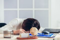 Tired woman at office desk in the evening. Tired woman at the office desk in the evening Stock Photo