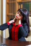 Tired woman in office holding hands on the aching neck. Tired woman in the office holding hands on the aching neck stock photo