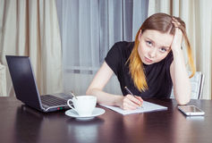 Tired woman at office stock images