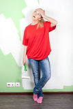 Tired woman with paint roller Royalty Free Stock Images