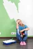 Tired woman  with paint tools Royalty Free Stock Photography