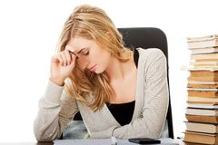 Tired woman preparing to exam Royalty Free Stock Photography