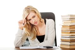 Tired woman preparing to exam Royalty Free Stock Photo