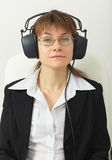 Tired woman with professional stereos ear-pho Stock Photography