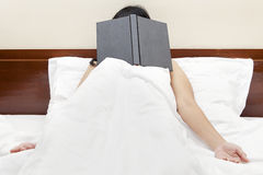 Tired woman after read a book Royalty Free Stock Image