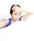 Tired woman relaxing in her bed Royalty Free Stock Images