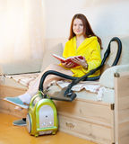Tired woman reposes from household chores Royalty Free Stock Images