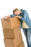 Tired Woman Resting On Stacked Cardboard Boxes Royalty Free Stock Photo