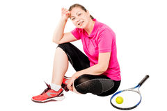 Tired woman resting after a workout while sitting on a white. Background Royalty Free Stock Photo