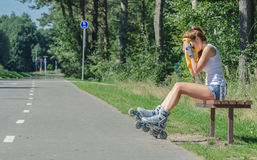 Tired woman on roller skates Stock Photography