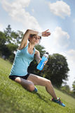 Tired woman runner taking a rest after run Stock Images