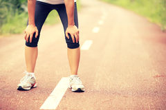 Tired woman runner taking a rest Royalty Free Stock Images