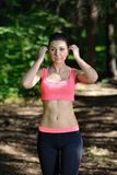 Tired woman runner taking rest after running workout in park Stock Images