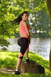 Tired woman runner taking rest after running workout in park Royalty Free Stock Photo