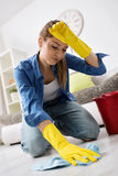 Tired woman scrubbing the floor Stock Photography
