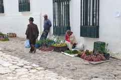 Tired woman selling goods in Villa de Leyva, Colombia.  royalty free stock image