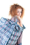 Tired woman with shopping bag. Royalty Free Stock Photo
