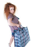 Tired woman with shopping bag. Royalty Free Stock Photography