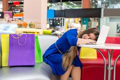 Tired woman after shopping fell asleep in cafeteria.  royalty free stock photos
