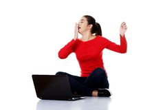 Tired woman sitting cross-legged with laptop.  Stock Photography
