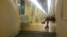 Tired woman sitting in subway carriage, going home after hard working day. Stock footage stock video footage