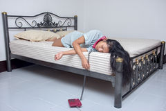Tired woman sleep in bed with the phone Stock Photography