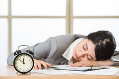 Tired woman are sleeping and holding smart phone. In the office Stock Image