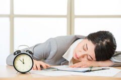 Tired woman are sleeping and holding smart phone. In the office Stock Images