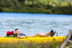 Tired Woman Sleeping in a Kayak Royalty Free Stock Image