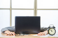 Tired woman are sleeping in the office. Tired woman are sleeping at desk in the office Stock Images