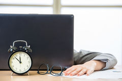 Tired woman are sleeping in the office. Tired woman are sleeping at desk in the office Royalty Free Stock Photo