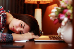 Tired woman sleeping on the table. At home Royalty Free Stock Images