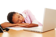 Tired woman sleeping at the workplace Royalty Free Stock Images