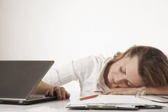Tired woman sleeping at the workplace excessive work, overwork,