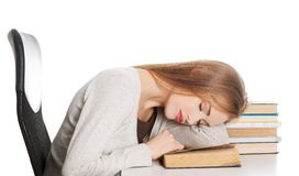 Tired woman slepping on books.  Royalty Free Stock Images