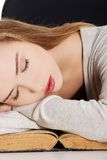 Tired woman slepping on books Stock Photos