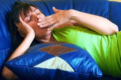Tired woman on sofa Stock Images