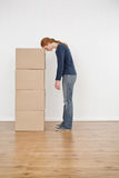 Tired Woman with a Stack of Boxes Royalty Free Stock Image