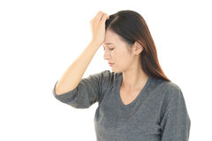 Tired woman. Tired and stressed Asian woman Royalty Free Stock Images