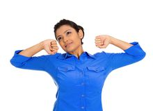 Tired woman stretching extending arms. Closeup portrait of pretty beautiful tired fatigued woman stretching extending arms, back, shoulders , yawning, isolated Royalty Free Stock Photo